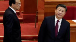 中國國家主席習近平和國務院總理李克強在人大會堂政協年會開幕式上。