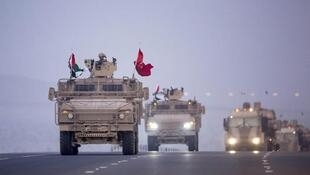 UAE military vehicles travel back from Yemen in 2015