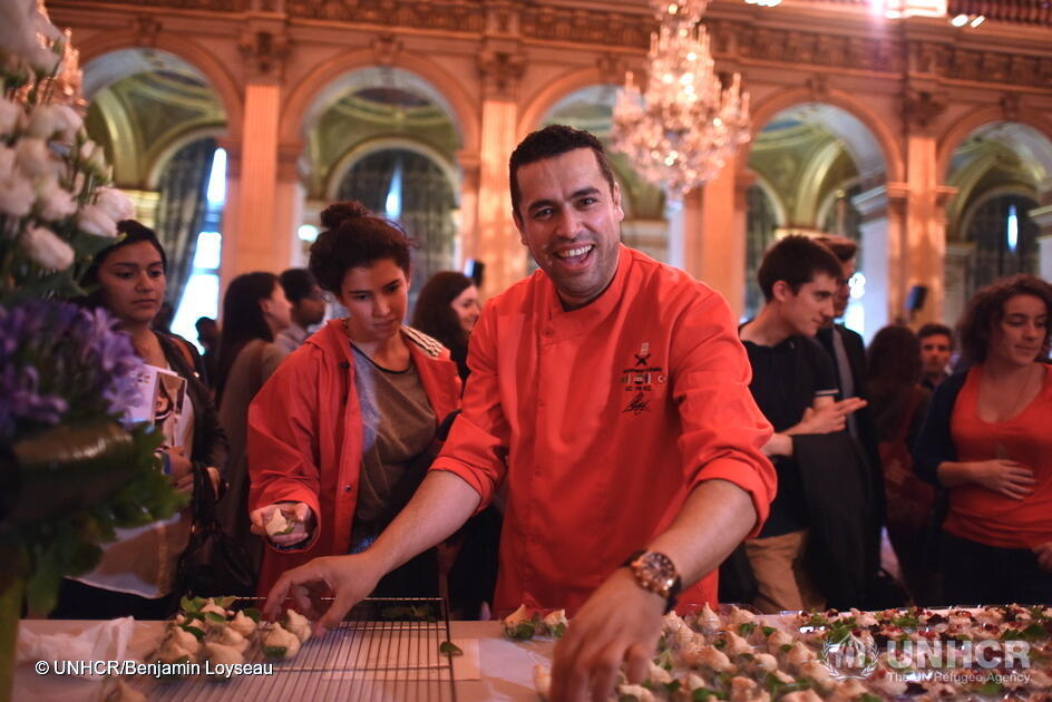 Syrian refugee chef Mohammad El Khaldy preparing food at Paris City Hall on June 20th 2016 as part of the Refugee Food Festival