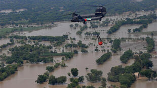 A helicopter flies food supplies over flood-hit areas in Punjab province.