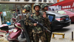 Paramilitary police officers outside a shopping mall in Hotan, Xinjiang in 2015