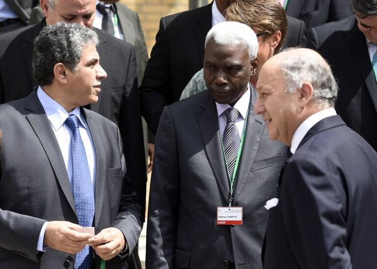 Le ministre de l'Environnement égyptien, Khaled Mohamed Fahmy Abdel Aal en compagnie du président de la Cop 21, Laurent Fabius et le ministre nigérien de l'Environnement, Adamou Chaiffou.