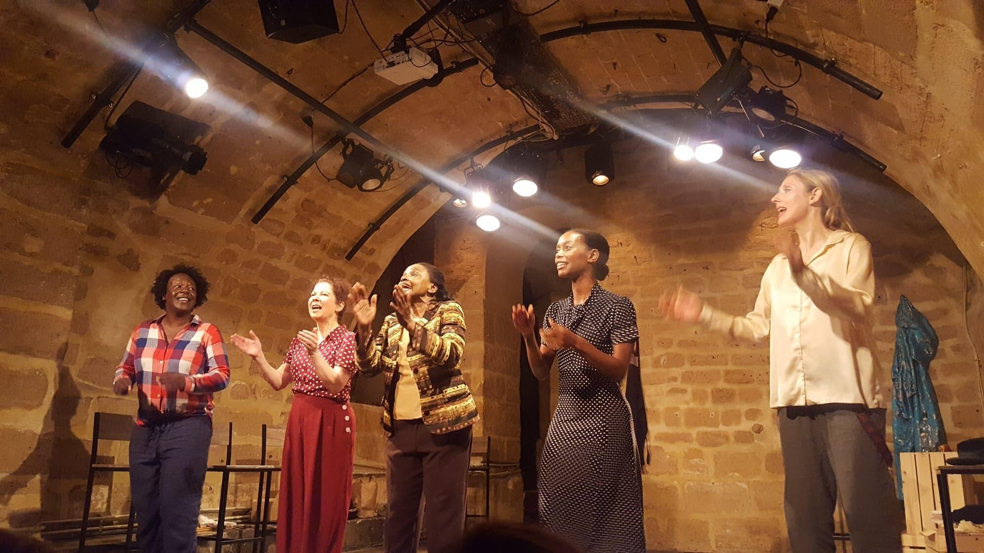Ursuline Kairson (in the middle) performs Maya Angelou in the play 'Maya, une voix,' or 'Maya, a voice,' 20 July 2019