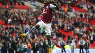 Aston Villa's Christian Benteke celebrates at the end of the semifinal against Liverpool