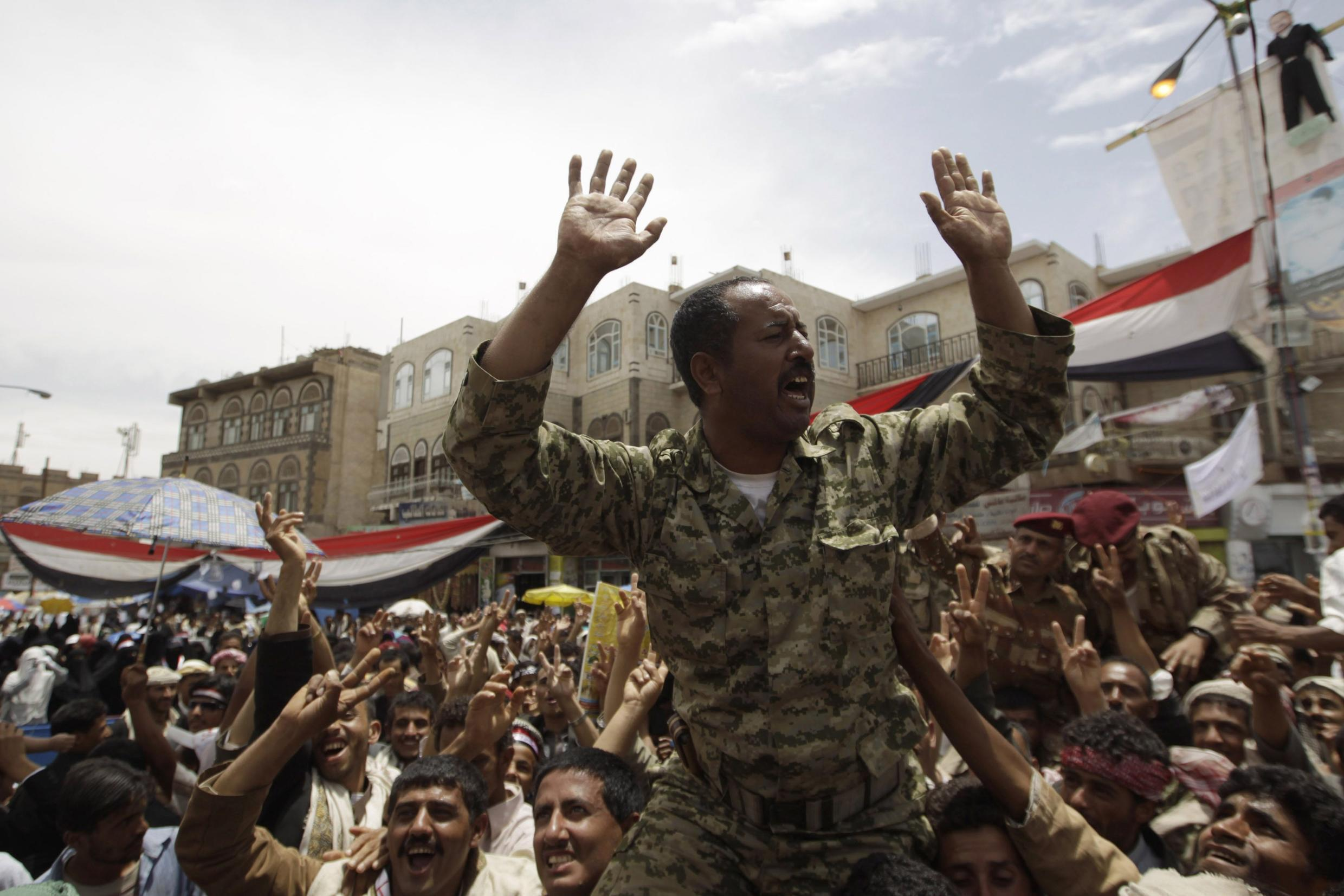 An army officer joins the protest in Sanaa on Saturday