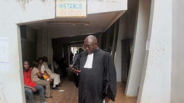 A lawyer waits in front of a court in Yaoundé, Cameroon