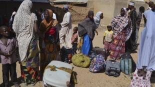 Familles de Gwoza, dans l'Etat de Brono, déplacées par la guerre contre Boko Haram, en février 2014.