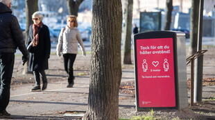 A sign in Stockholm asking residents to respect social distancing regulations. Soon, they may have vaccinations passports.