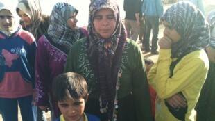 Femmes et enfants syriens refugiés.