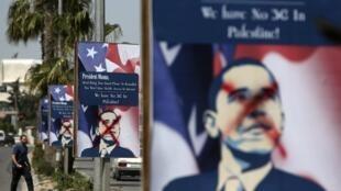 Dans les rues de Ramallah, des portraits de Barack Obama ont été couverts de graffitis.