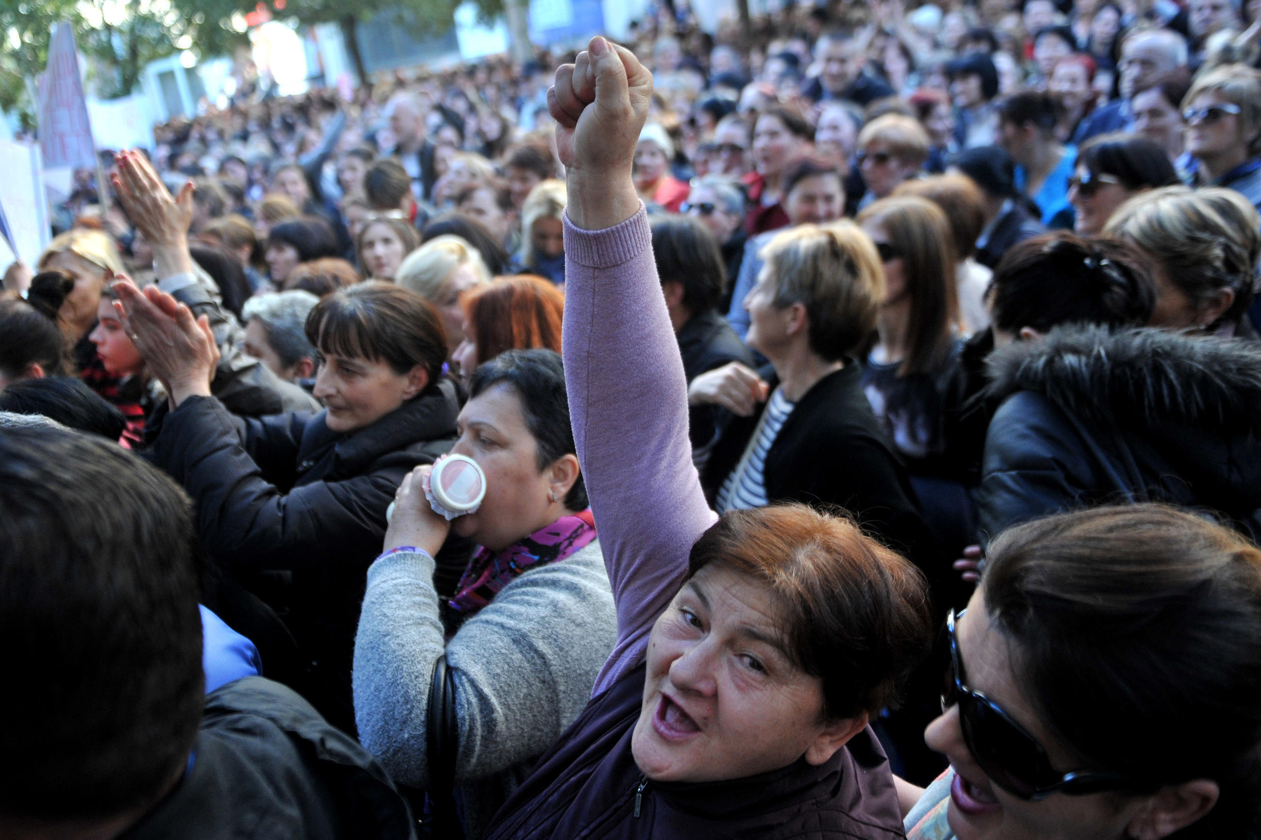 Women in Montenegro protest against government planst to cut social benefits in February, 2017