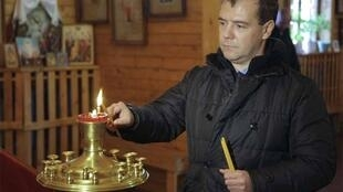 President Dmitry Medvedev visits a church on Kunashiri Island