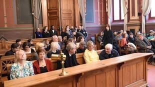 Violet Price's family and friends wait before the opening of the trial of Madi Mahaboubi
