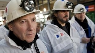 French miners protest outside the trial of two Eternit bosses in Italy in February