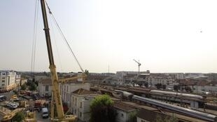 A crane has been brought in to remove overturned train carriages at Brétigny-sur-Orge station.