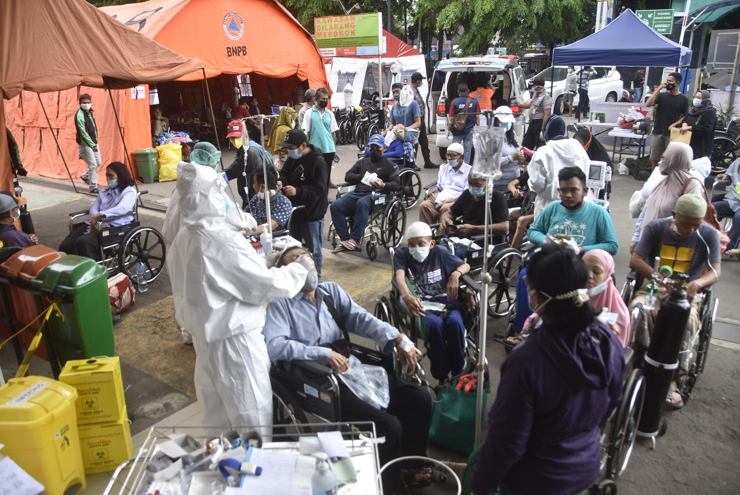Medical staff test people for Covid-19 outside a hospital in Bekasi, Indonesia