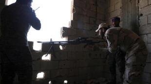 Des membres des Forces démocratiques syriennes à Raqqa, le 31 juillet 2017.