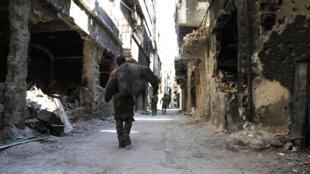 Палестинский лагерь в Ярмуке, пригороде Дамаска. 6 апреля 2015.