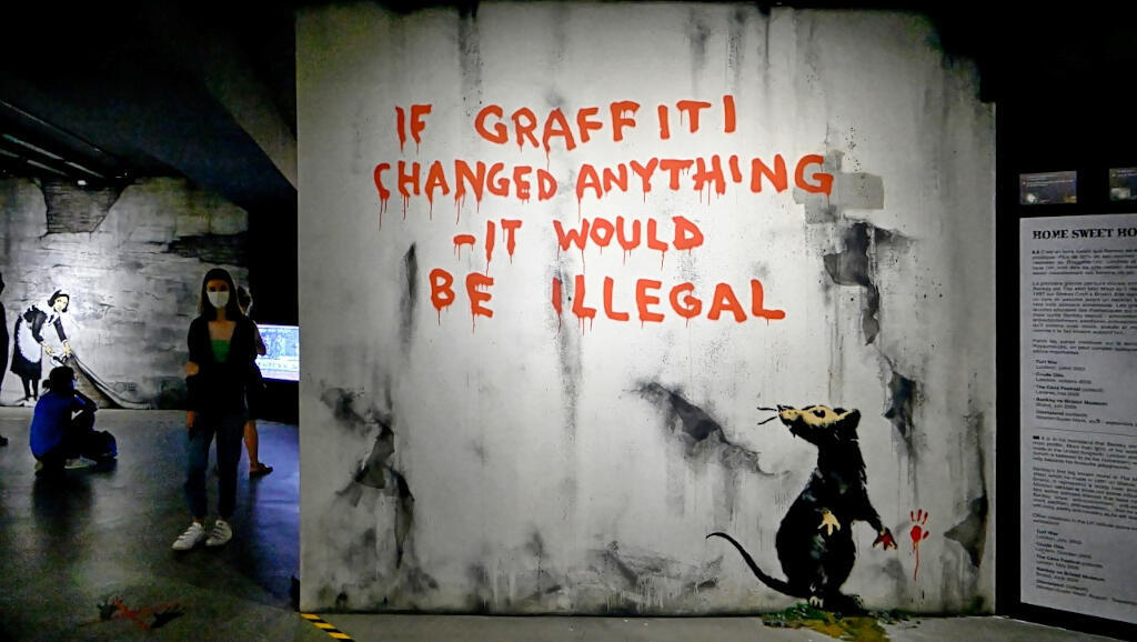 """""""If graffiti changed anything – it would be illegal"""" appeared on a wall in Fitzrovia, central London during Easter Monday 2011. The work in blood red paint features the stencilled rat which has appeared in many of Banksy's creations."""