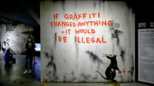 """If graffiti changed anything – it would be illegal"" appeared on a wall in Fitzrovia, central London during Easter Monday 2011. The work in blood red paint features the stencilled rat which has appeared in many of Banksy's creations."
