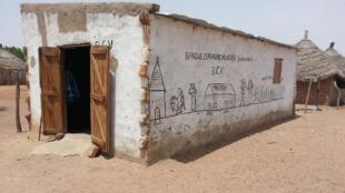 Sénégal - banque de céréales - Sinthiou Malème - Le Coq chante