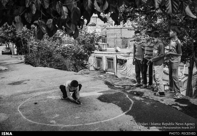 یکی از عکسهای عبدالله حیدری از زندگی کودکان
