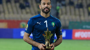 Morocco and Raja Casablanca star Anas Zniti holds the trophy awarded to the best goalkeeper after the African Nations Championship in Cameroon this year