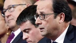 French President François Hollande (R), Prime Minister Manuel Valls (C) and Finance Minister Michel Sapin (R)