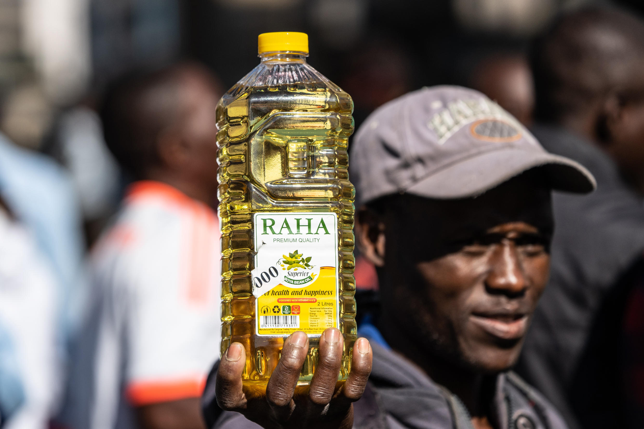 Inflation anger: A protester holds a bottle of cooking oil during a demonstration in Harare last August over the cost of food