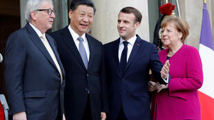 French President Emmanuel Macron, Chinese President Xi Jinping, German Chancellor Angela Merkel and European Commission President Jean-Claude Juncker pose before a meeting at the Elysee Palace in Paris, France, March 26, 2019.