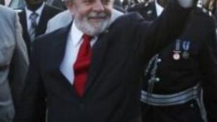 Brazil's President Luiz Inacio Lula Da Silva waves to people  at Lusaka International Airport