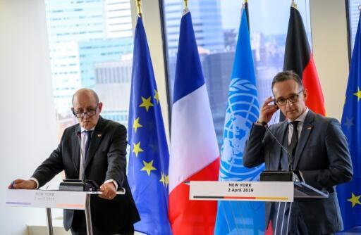 France's Foreign Minister Jean-Yves Le Drian (L) and Germany's Foreign Minister Heiko Maas speak to reporters on April 2, 2019 at the French Mission to the United Nations in New York