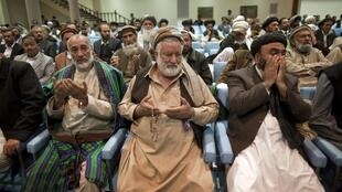 Delegates to the loya jirga, meeting in Kabul, pray