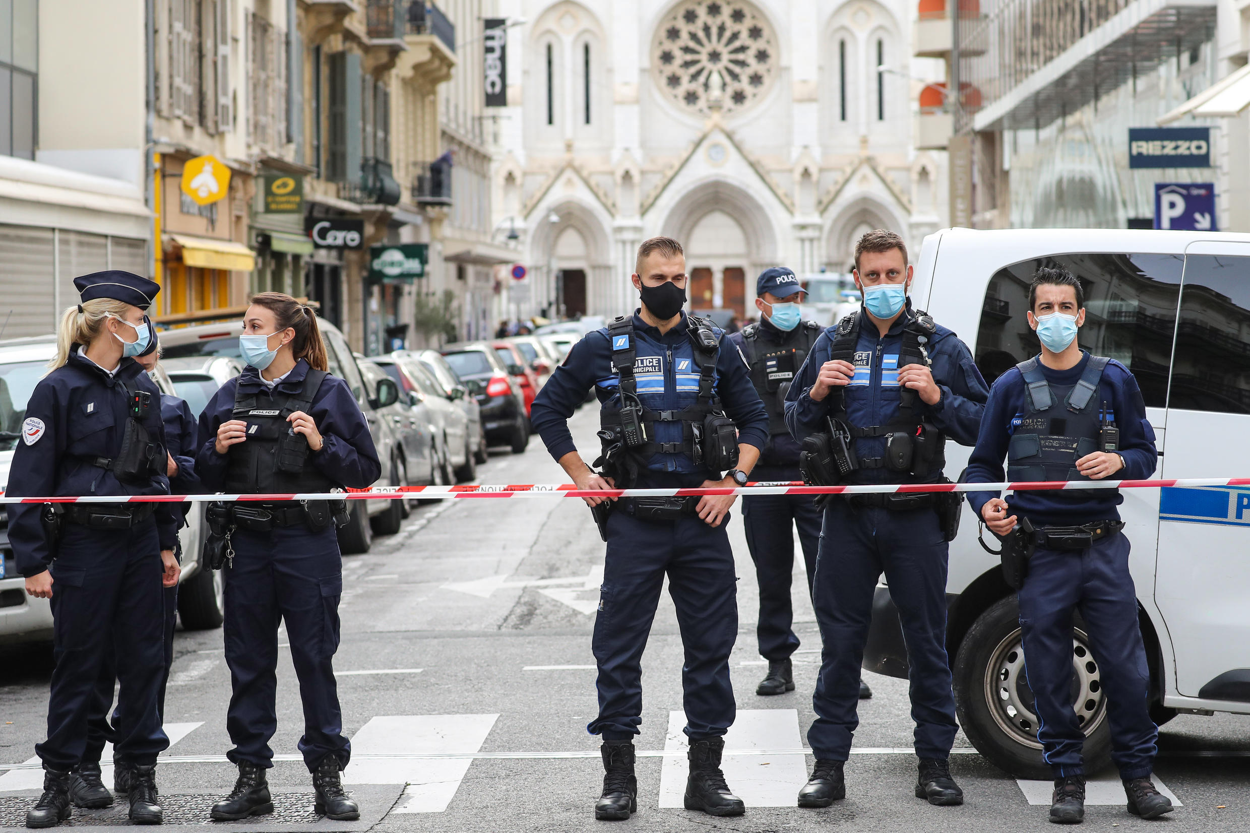 """Police block access to the Notre-Dame de l'Assomption Basilica in Nice where a knife-wielding young Tunisian killed three people in an attack the authorities are treating as an act of """"Islamist terror"""""""