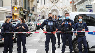 "Police block access to the Notre-Dame de l'Assomption Basilica in Nice where a knife-wielding young Tunisian killed three people in an attack the authorities are treating as an act of ""Islamist terror"""
