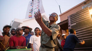 An electoral official shows a ballot paper for Madagascar's presidential election, on 7 November 2018.