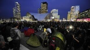 Indignant demonstrators set up tents at the La Defense business district near Paris