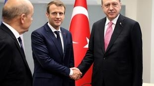 This file photo taken on September 19, 2017 shows French President Emmanuel Macron (L) shaking hands with Turkish President Recep Tayyip Erdogan at UN Headquarters in New York during the 72nd UN General Assembly.