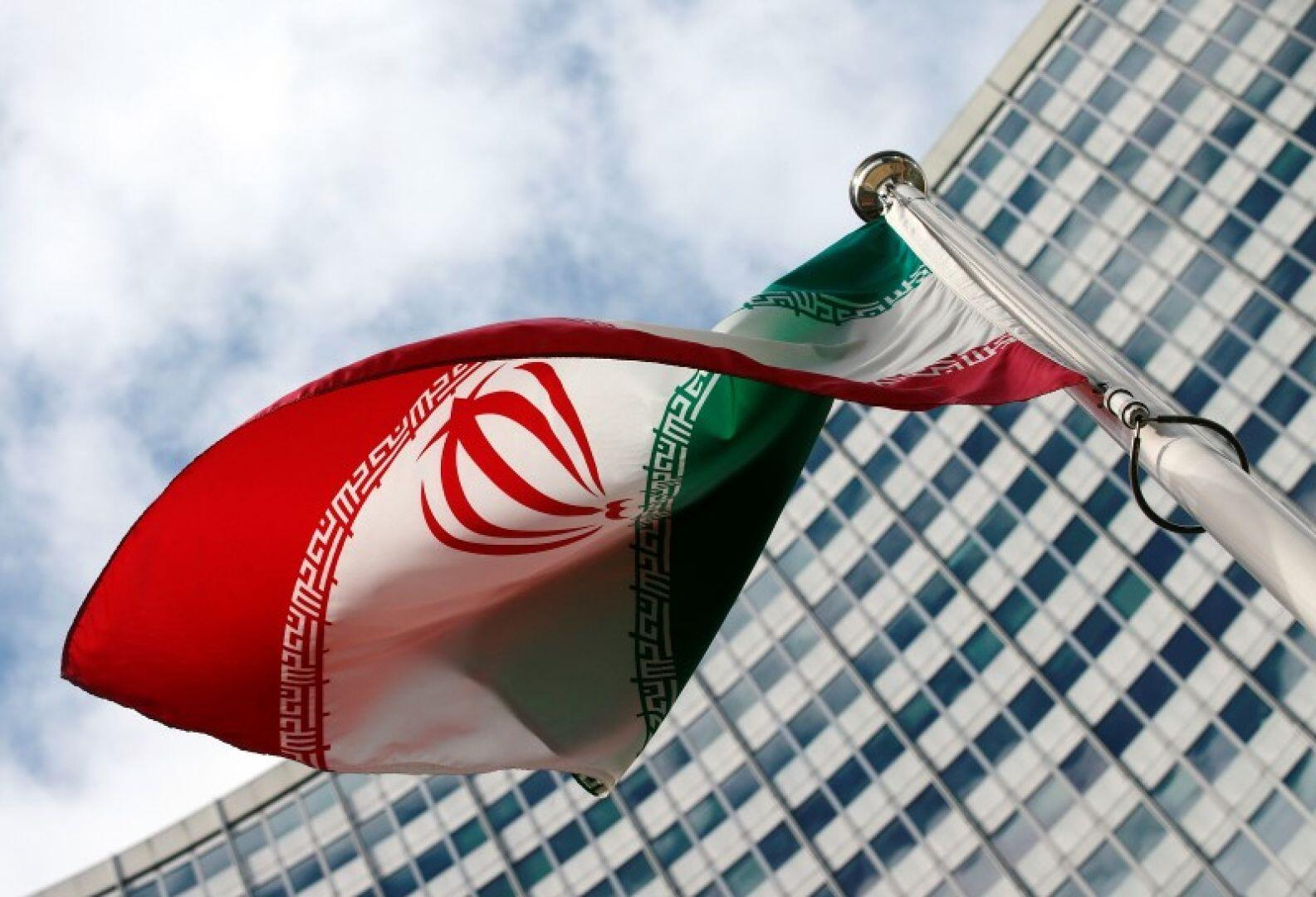 Iran's flag flying in front of the IAEA headquarters in Vienna.