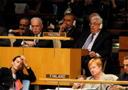 The Palestinian delegation, including President Mahmoud Abbas (top R), listens as US President Barack Obama addresses the UN General Assembly in New York.