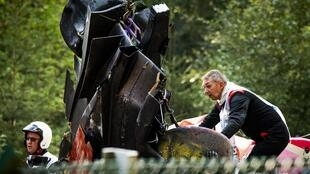 Track marshals work on the wreckage of Anthoine Hubert's car at the Spa-Francorchamps circuit in Belgium.
