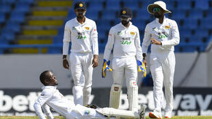 Down but not out: Nkrumah Bonner suffers cramp during his match-saving innings