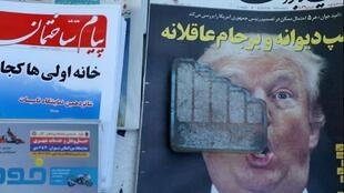 A newspaper featuring a picture of U.S. President Donald Trump is seen in Tehran, Iran, October 14, 2017.