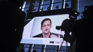 Edward Snowden found refuge in Russia. He often speaks at video conferences to make his voice heard.