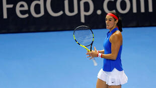 Caroline Garcia claimed her second win over Petra Kvitova to restore parity in the Fed Cup final..