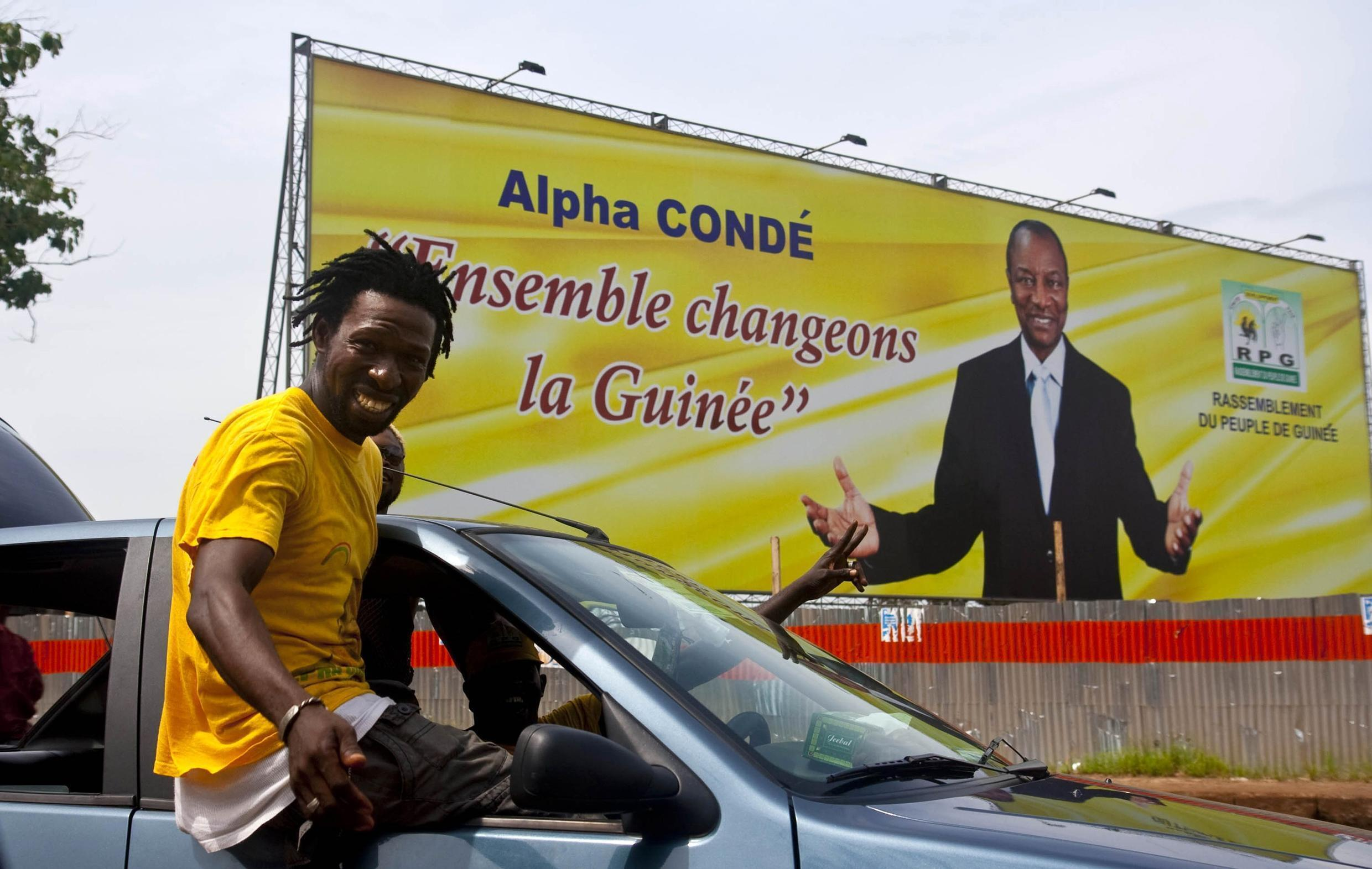 Supporters of Guinea's President elect Alpha Conde celebrate his victory