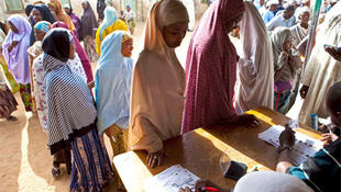 Women queue at polling stations in Kano, 9 April 2011.