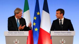 O Presidente francês Emmanuel Macron e o Primeiro-ministro italiano Paolo Gentiloni em Lyon, no 27 de Setembro de 2017.