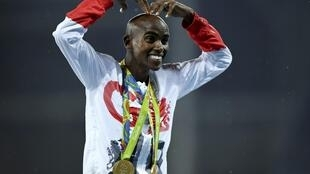 Britain's Mo Farah wearing his two medals achieved at Rio on Saturday evening.