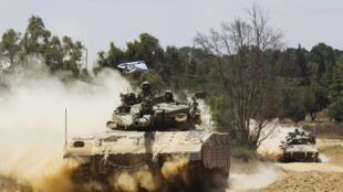 Израильский танк на границе с сектором Газа 18 июля 2014.